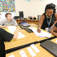 Emily Carodine, a fifth grade reading teacher at Pierce Street Elementary School, goes over vocabulary a project with one of her students Tyler Fields, 11, on Thursday morning in Tupelo. Pierce Street received an A rating this year from state testing.