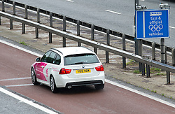 © London News Pictures. 16/07/2012. London, UK. An official Olympics vehicle travelling on the M4 Olympic lane on July 16, 2012 which opened today. Journeys for Olympic officials and athletes into central London are intended to be eased by the Olympic lane on the M4 motorway, which is the main route in to central London from Heathrow airport. Photo credit: Ben Cawthra/LNP.