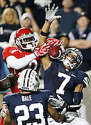 Utah wide receiver DeVonte Christopher (10) is unable to come up with a 14-yard Jordan Wynn pass in the endzone as BYU cornerback Preston Hadley (7) and safety Travis Uale (23) defends during the second half of an NCAA college football game, Saturday, Sept. 17, 2011, at LaVell Edwards Stadium in Provo, Utah. Utah defeated BYU 54-10. (AP Photo/Colin E Braley)..