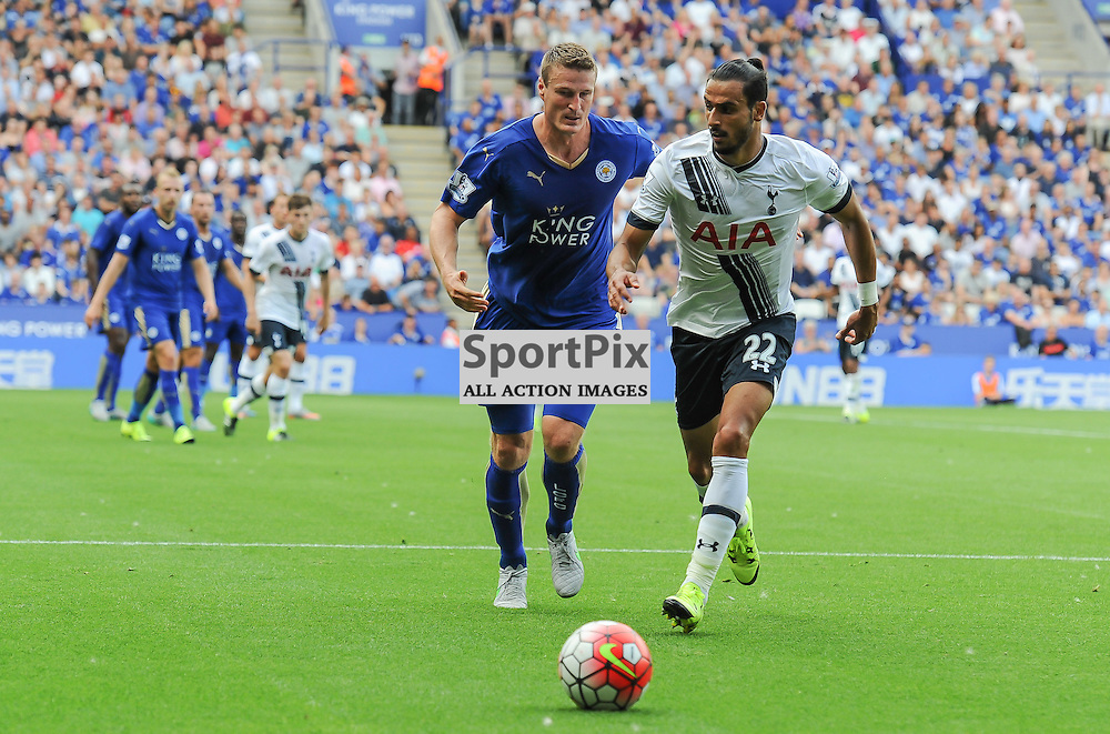 Nacer Chadli chases a loose ball with Robert Huth on his shoulder (c) Simon Kimber | SportPix.org.uk