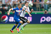 (R) Legia's Ivica Vrdoljak fights for the ball with (L) Lech's Rafal Murawski during T-Mobile Extraleague soccer match between Legia Warsaw and Lech Poznan at Pepsi Arena in Warsaw, Poland...Poland, Warsaw, May 18, 2013..Picture also available in RAW (NEF) or TIFF format on special request...For editorial use only. Any commercial or promotional use requires permission...Photo by © Adam Nurkiewicz / Mediasport