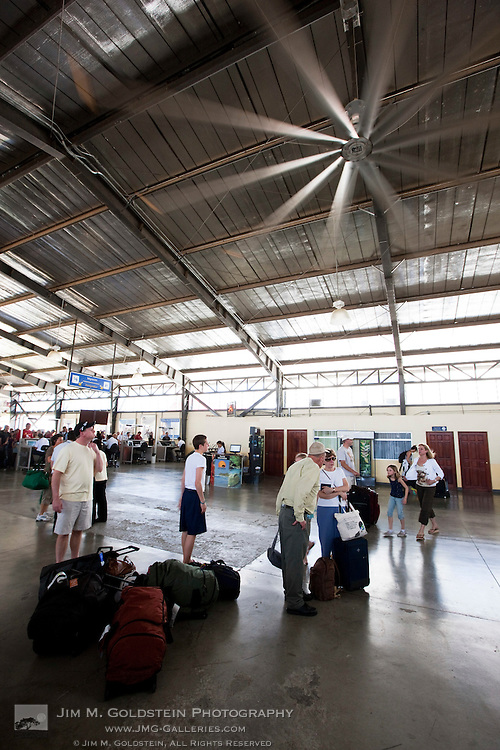 A giant fan cools air travelers at the Liberia Airport in Costa Rica