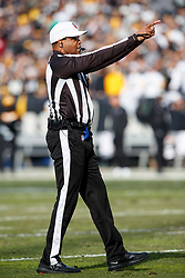 OAKLAND, CA - DECEMBER 09: NFL referee Ron Torbert #62 before a play during the second quarter between the Oakland Raiders and the Pittsburgh Steelers at the Oakland Coliseum on December 9, 2018 in Oakland, California. The Oakland Raiders defeated the Pittsburgh Steelers 24-21. (Photo by Jason O. Watson/Getty Images) *** Local Caption *** Ron Torbert