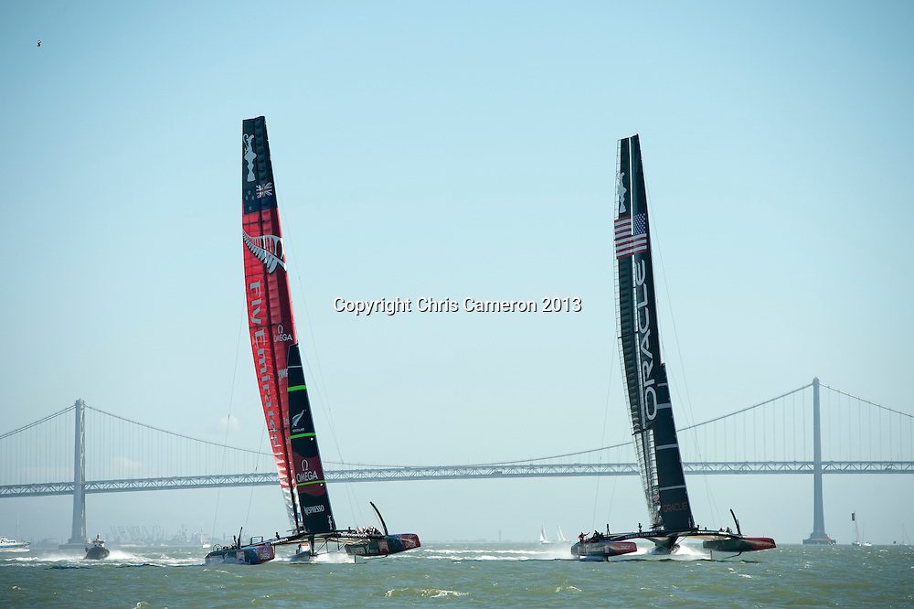 Oracle Team USA sailover Emirates Team New Zealand on the beat in race 18.  America's Cup 34. 24/9/2013