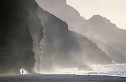 Ocean spray and cliffs at Kalalau beach on the Napali Coast Trail in Kauaii, considered one of the world's best hikes.