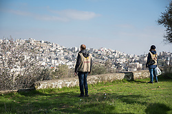 2 March 2020, Hebron: Daniel from Switzerland and Nora from Finland, both participants in the Ecumenical Accompaniment Programme in Palestine and Israel look out over Hebron from a vantage point in the area of Tel Rumeida, Hebron.