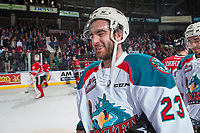 KELOWNA, CANADA - APRIL 14: Reid Gardiner #23 of the Kelowna Rockets stands on the ice all smiles after scoring 4 goals to lead the team to a 6-2 game 5 and series win against the Portland Winterhawks on April 14, 2017 at Prospera Place in Kelowna, British Columbia, Canada.  (Photo by Marissa Baecker/Shoot the Breeze)  *** Local Caption ***
