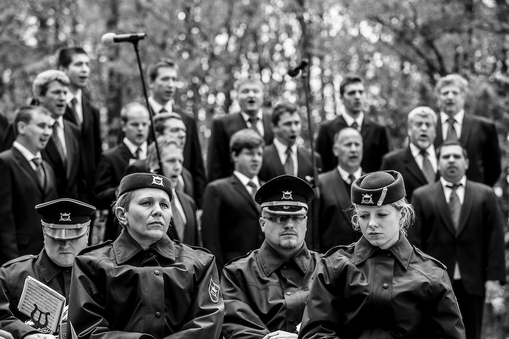 26.4.2014, members of Slovene army orchestra in front of mens choir Srečko Kosovel during ceremony on anniversary of the battle on Nanos(mountain near Ajdovscina, Primorska region, Slovenia) and the feast day on the day of the revolt against the italian occupier in second world war.   Nanos, Primorska region, Slovenia
