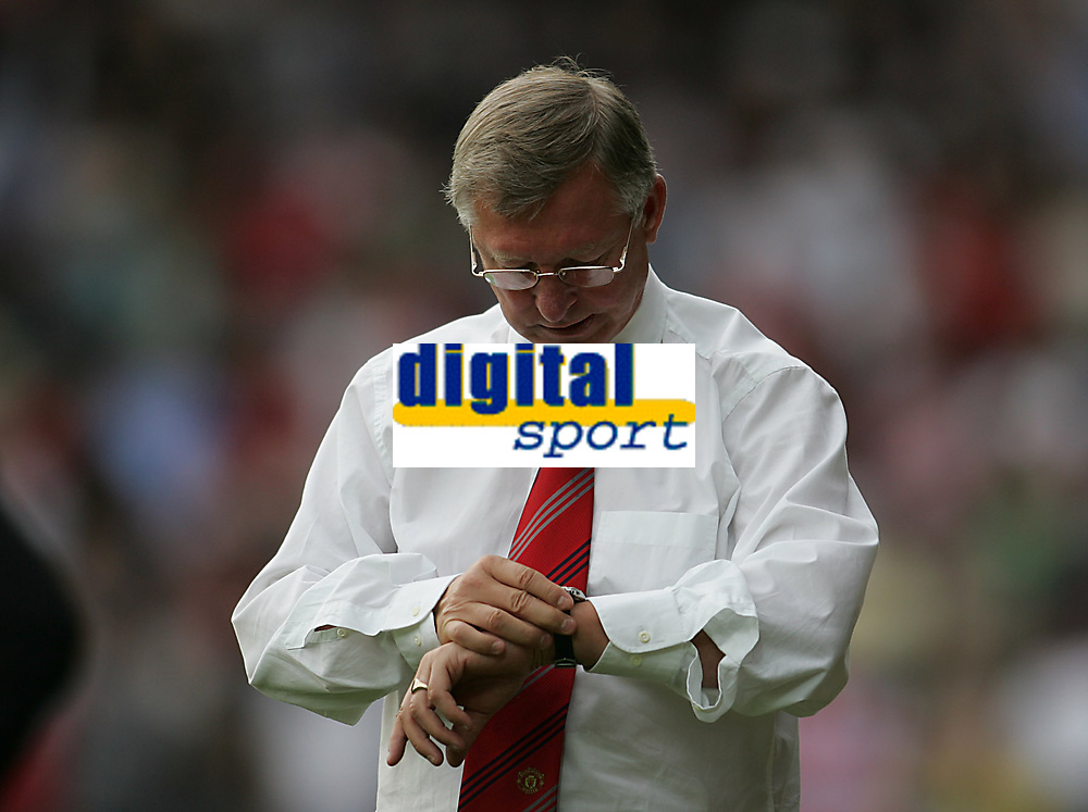 Photo: Lee Earle.<br /> Watford v Manchester United. The Barclays Premiership. 26/08/2006. United manager Sir Alex Ferguson checks his watch as injury time is played.