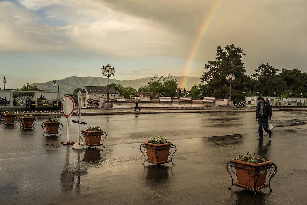 A rainbow arcs over Renaissance Square in the city center following a rain storm on Sunday, May 8, 2016 in Stepanakert, Nagorno-Karabakh.