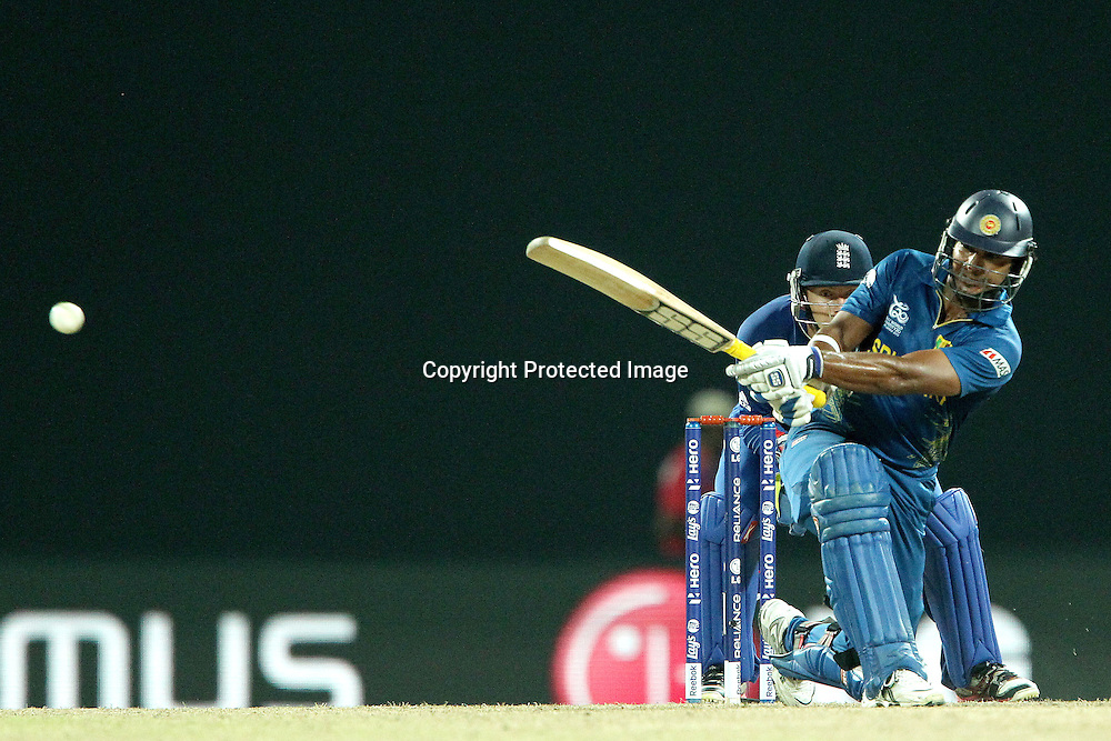 Kumar Sangakkara sweeps a delivery from Samit Patel of England  during the ICC World Twenty20 Super Eights match between England and Sri Lanka held at the  Pallekele Stadium in Kandy, Sri Lanka on the 1st October 2012<br /> <br /> Photo by Ron Gaunt/SPORTZPICS