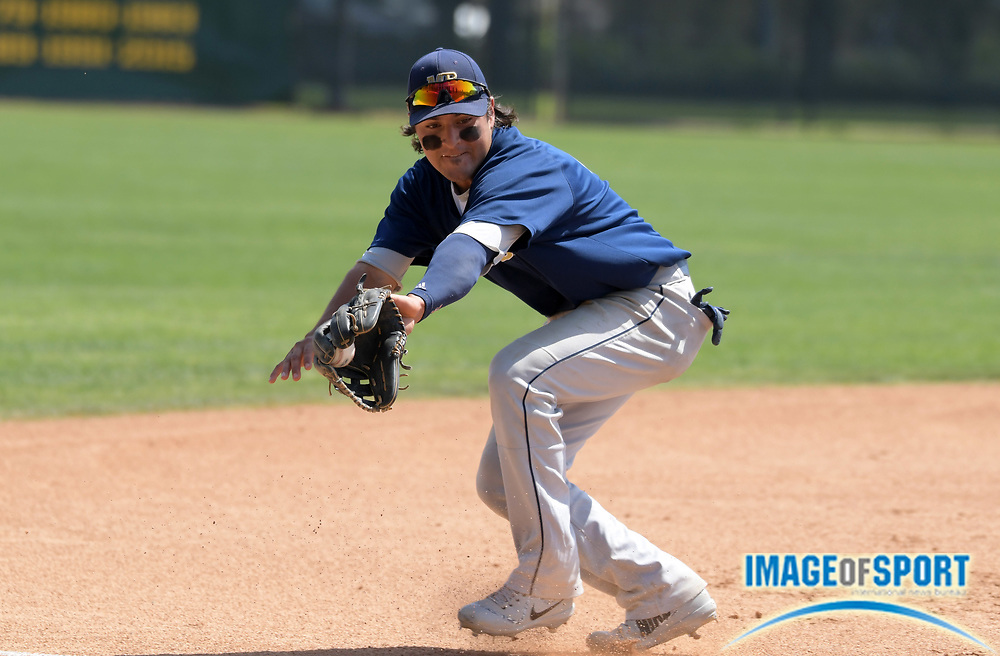 Cal State Monterey Bay Otters third baseman Ruben Gonzalez (4) field a ground ball during an NCAA College baseball game against the Cal  Poly Pomona Broncos in Pomona, Calif., Friday, April 13, 2018.