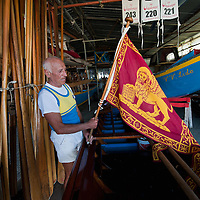 "VENICE, ITALY - SEPTEMBER 04:  A member of the Voga Veneta Lido arranges a ""Serenissma"" flag  during preparations  ahead of Sunday Historic Regata on September 4, 2010 in Venice, Italy. The Historic Regata is the most exciting rowing race on the Gran Canal for the locals and one of the most spectacular ***Agreed Fee's Apply To All Image Use***.Marco Secchi /Xianpix. tel +44 (0) 207 1939846. e-mail ms@msecchi.com .www.marcosecchi.com"