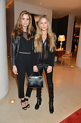 Left to right, MEGAN DAVIS and HUM FLEMING at the launch of hidden bar 'Blind Spot' at St.Martin's Lane Hotel, St.Martin's Lane, London on 6th May 2015.