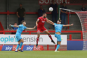 Sean Long, Ollie Palmer and Charlie Raglan   during the EFL Sky Bet League 2 match between Crawley Town and Cheltenham Town at The People's Pension Stadium, Crawley, England on 31 August 2019.
