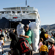 A day after a fatal fire killed at least two and clashes between asylum seekers and police took place, asylum seekers board the ferry to Athens from Moria camp. Authorities planned to move 200+ asylum seekers from the camp on Lesvos Island in Greece on Monday, September 30, 2019.