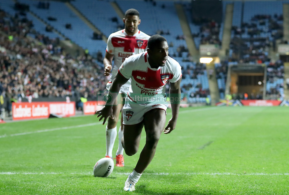 England's Jermain McGillvary scores his sides fifth try during the Four Nations match at the Ricoh Arena, Coventry.