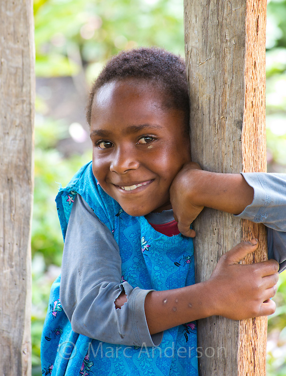 Young girl smiling in a village in the Papua New Guinea Highlands.