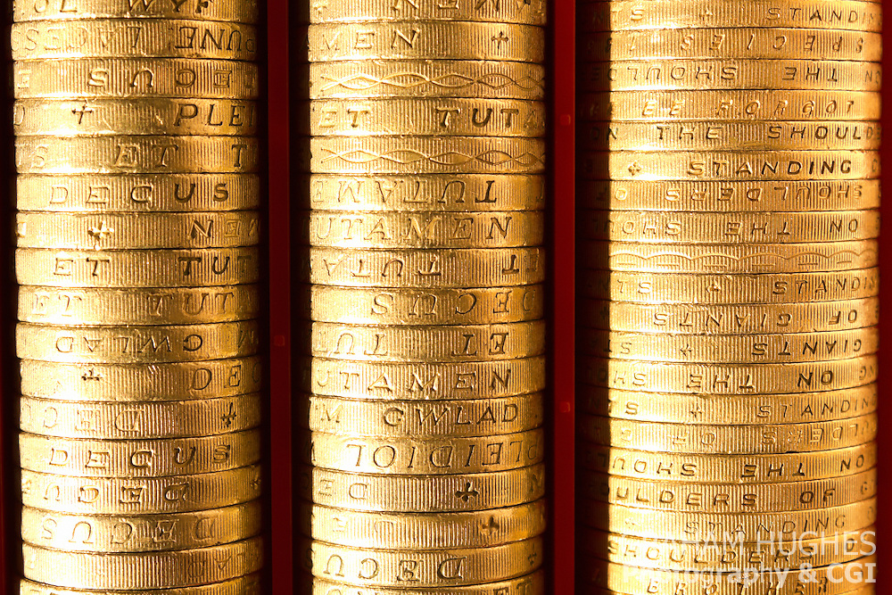 Close up of pound coins in coin hopper.