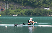 Aiguebelette, FRANCE. NZL M1X,  Mahe DRYSDALE, heading for the finishing line at the 2014 FISA World Cup II. 13:55:02  Sunday  22/06/2014. [Mandatory Credit; Peter Spurrier/Intersport-images]