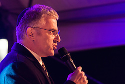 Trafalgar Square, London, December 16th 2014.  London's Jewish community celebrates Chanukah in the Square which marks the beginning of the Jewish festival of lights. The annual event is presented by the Jewish Leadership Council, London Jewish Forum and Chabad and is supported by the Mayor of London.  PICTURED : Israel's Ambassador to the United Kingdom Daniel Taub addresses the crowd in Trafalgar Square.