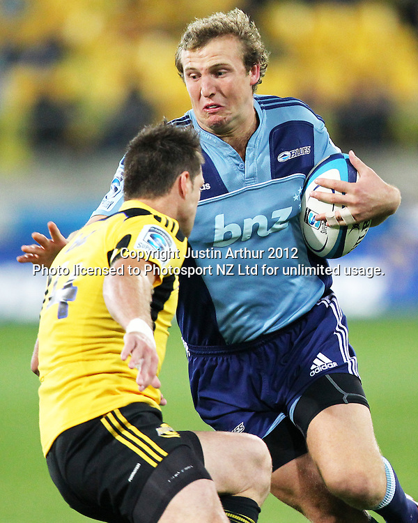 Blues' Hadleigh Parkes  looks to evade Hurricanes' Cory Jane during the 2012 Super Rugby season, Hurricanes v Blues at Westpac Stadium, Wellington, New Zealand on Friday 4 May 2012. Photo: Justin Arthur / photosport.co.nz