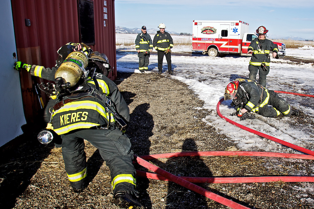 Lt. Mike Mather reacts as Lt. Kevin Croffoot crashes to the ground outside the training tower for Northern Lakes Fire Protection District during a training session Wednesday, Jan. 25, 2012 in Hayden, Idaho.