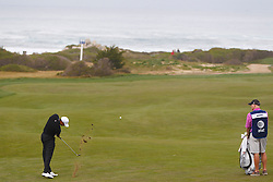 Feb 10, 2012; Pebble Beach CA, USA; Tiger Woods hits his second shot on the eighth hole during the second round of the AT&T Pebble Beach Pro-Am at Monterey Peninsula Country Club. Mandatory Credit: Jason O. Watson-US PRESSWIRE
