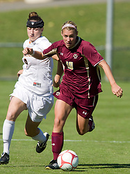 Virginia Cavaliers forward Lauren Alwine (9) tries to grab possession from Boston College Eagles midfielder Kelly Henderson (10).  The #9 ranked Virginia Cavaliers defeated the #13 ranked Boston College Eagles 2-1 in NCAA women's soccer at Klockner Stadium on the Grounds of the University of Virginia in Charlottesville, VA on October 19, 2008.