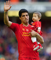 LIVERPOOL, ENGLAND - Sunday, May 11, 2014: Liverpool's Luis Suarez with his son Benjamin after the Premiership match against Newcastle United at Anfield. (Pic by David Rawcliffe/Propaganda)