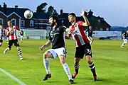 Ollie Palmer (8) of Lincoln City holds off Jordan Storey (38) of Exeter City during the EFL Sky Bet League 2 match between Exeter City and Lincoln City at St James' Park, Exeter, England on 17 May 2018. Picture by Graham Hunt.