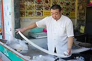 Stretching noodles. Nanshan Buddhism Culture Park. Sanya, Hainan province of southern China. 15//2/2012