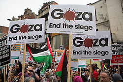 Image ©Licensed to i-Images Picture Agency. 11/07/2014. London, United Kingdom. Demonstration in London against Israeli strikes in Gaza. Central London. Protesters hold banners against Israeli strikes in Gaza in a demonstration outside the Israeli embassy. Picture by Daniel Leal-Olivas / i-Images