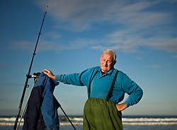 © Licensed to London News Pictures. <br /> 12/10/2014. <br /> <br /> Saltburn, United Kingdom<br /> <br /> Bill Stocker from Skelton poses for a picture during the annual Jim Maidens memorial beach fishing competition in Saltburn by the Sea in Cleveland. <br /> The competition is held each year to mark the death of Saltburn plumber and keen fisherman Jim Maidens who died in 1998 when he was killed after being swept overboard from his boat 'Corina' close to the beach at Saltburn.<br /> <br /> Photo credit : Ian Forsyth/LNP