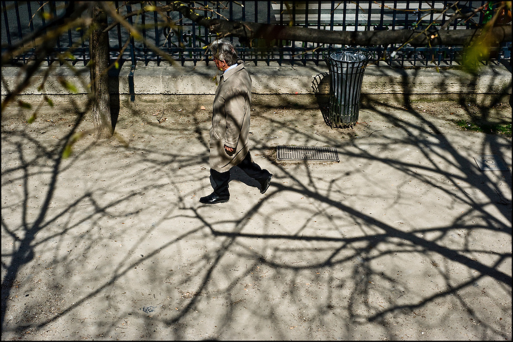 A man is seen in Jardin des Tuileries, center of Paris.