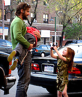 **EXCLUSIVE**.Bart Freundlich, Julienne Moore's husband with his daughter - and a friend's son on his arms - playing outside of Bar Pitti Restaurant where they had dinner with friends..West Village.New York, NY, USA .Sunday, April, 29, 2007.Photo By Celebrityvibe.To license this image call (212) 410 5354 or;.Email: celebrityvibe@gmail.com; .
