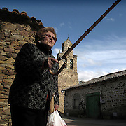 Old woman in Santa Catalina de Somoza.  Maragateria area . Leon province . Spain . The WAY OF SAINT JAMES or CAMINO DE SANTIAGO following the French Route, between Saint Jean Pied de Port and Santiago de Compostela in Galicia, SPAIN. Tradition says that the body and head of St. James, after his execution circa. 44 AD, was taken by boat from Jerusalem to Santiago de Compostela. The Cathedral built to keep the remains has long been regarded as important as Rome and Jerusalem in terms of Christian religious significance, a site worthy to be a pilgrimage destination for over a thousand years. In addition to people undertaking a religious pilgrimage, there are many travellers and hikers who nowadays walk the route for non-religious reasons: travel, sport, or simply the challenge of weeks of walking in a foreign land. In Spain there are many different paths to reach Santiago. The three main ones are the French, the Silver and the Coastal or Northern Way. The pilgrimage was named one of UNESCO's World Heritage Sites in 1993. When there is a Holy Compostellan Year (whenever July 25 falls on a Sunday; the next will be 2010) the Galician government's Xacobeo tourism campaign is unleashed once more. Last Compostellan year was 2004 and the number of pilgrims increased to almost 200.000 people.