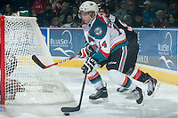 KELOWNA, CANADA - JANUARY 3: Rourke Chartier #14 of Kelowna Rockets tries to score a wrap around goal against the Prince George Cougars on January 3, 2015 at Prospera Place in Kelowna, British Columbia, Canada.  (Photo by Marissa Baecker/Shoot the Breeze)  *** Local Caption *** Rourke Chartier';