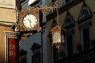 Clock on corner of Piazza della Signoria, Florence, Italy