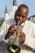 Trumpeter James Andrews performs near Jackson Square and St. Louis Cathedral