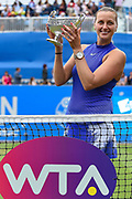 Petra Kvitova of the Czech Republic wins her match (4-6) (6-3) (6-2) and holds up the trophy during the Final of the Aegon Classic Birmingham at Edgbaston Priory Club, Edgbaston, United Kingdom on 25 June 2017. Photo by Martin Cole.