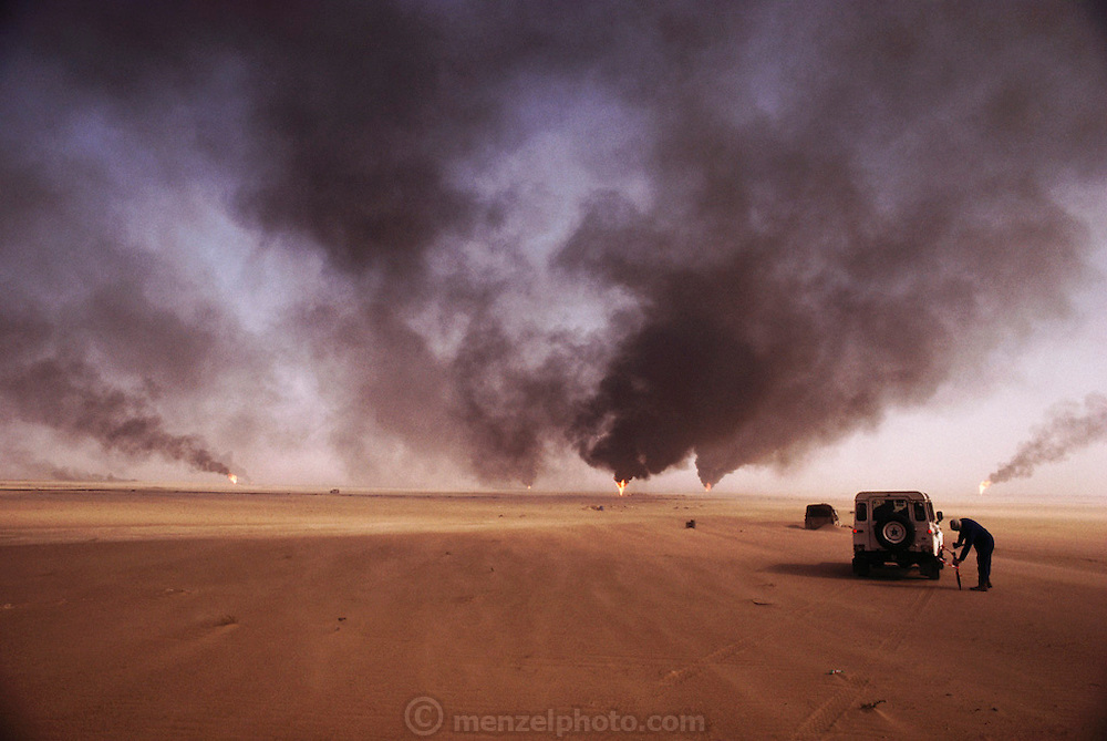 The British Explosive Ordinance Disposal Team marking a safe route to drive through the Manageesh Oil field in Kuwait. After finding rockeye submunitions (cluster bombs) all over Kuwait, they detonate them with plastic explosives from a safe distance. Nearly a million land mines were deployed on the beaches and along the Saudi and Iraqi border. In addition, tens of thousands of unexploded bomblets (from cluster bombs dropped by Allied aircraft) littered the desert. July 1991. More than 700 wells were set ablaze by retreating Iraqi troops creating the largest man-made environmental disaster in history.