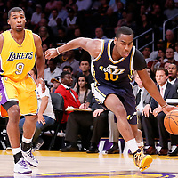 19 October 2014: Utah Jazz guard Alec Burks (10) drives past Los Angeles Lakers guard Ronnie Price (9) during the Los Angeles Lakers 98-91 victory over the Utah Jazz, in a preseason game, at the Staples Center, Los Angeles, California, USA.