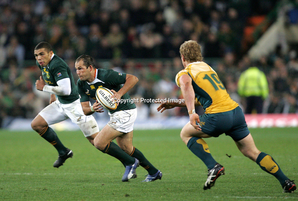 Fourie du Preez attacks with Bryan Habana in support while David Pocock defends during the first 2009 tri-nations test match between South Africa and Australia held on the 8 August 2009 at Newlands Stadium in Cape Town, South Africa..Photo by RG/www.sportzpics.net.+27 (0) 21 785 6814