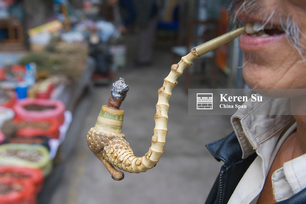 A carved pipe at the market, Guizhou, China