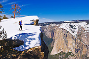 Backcountry skier at Taft Point, Yosemite National Park, California USA