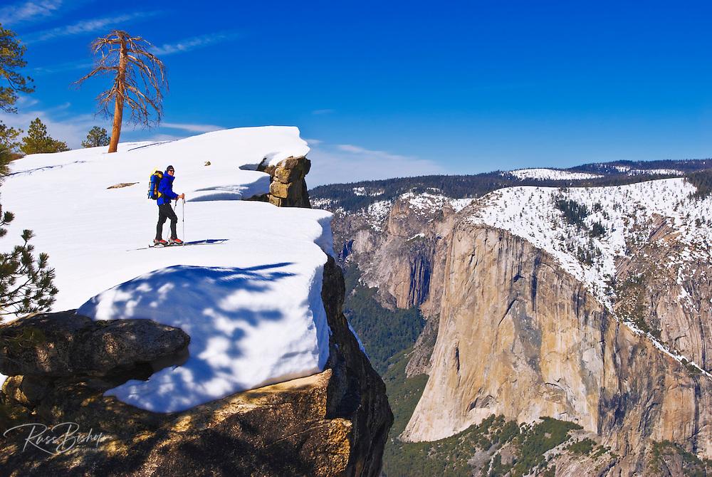 Backcountry skier at Taft Point, Yosemite National Park, California USA
