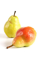 Close-up of pears on white background