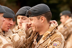 ©under licence to London News Pictures. 15/01/2011.  Homecoming Parade for the Gunners of 1 Squadron RAF Regiment in Bury St Edmunds.  Gunners laughing and joking.  The Mayor Councillor Ian Houlder & Station Commander of Honington Grp Capt Andy Hall. welcomed all to join him in greeting the troops. Parade Led by the Central Band of the RAF.  Station Commander of Honington Grp Capt Andy Hall. Photo credit should read Jason Patel/London News Pictures