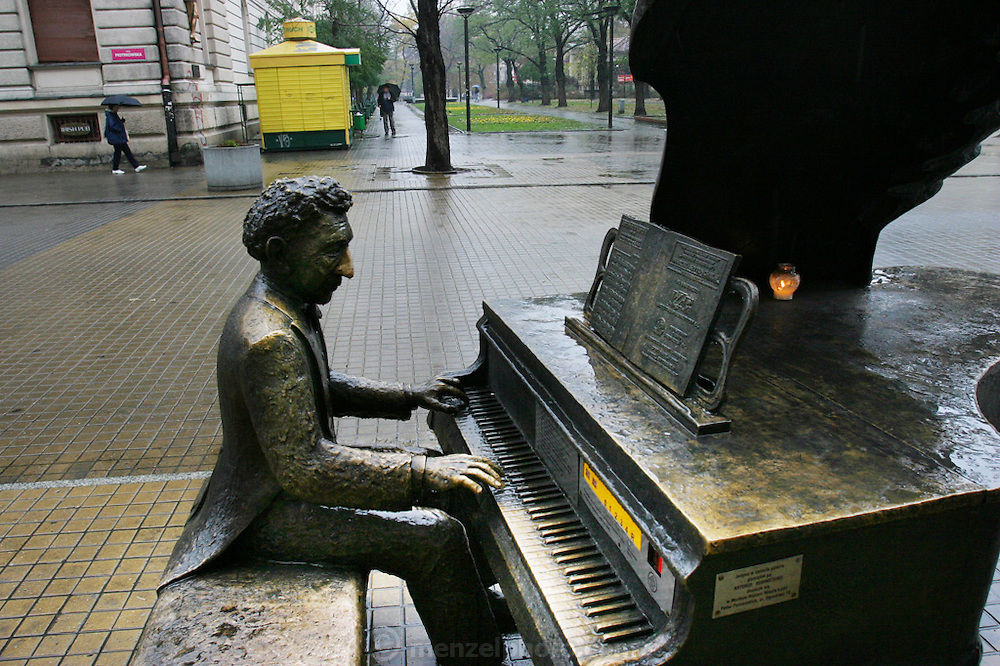 Lodz, Poland main street. (Piotrkowska St.) Bronze statue of Arthur Rubenstein playing his piano.